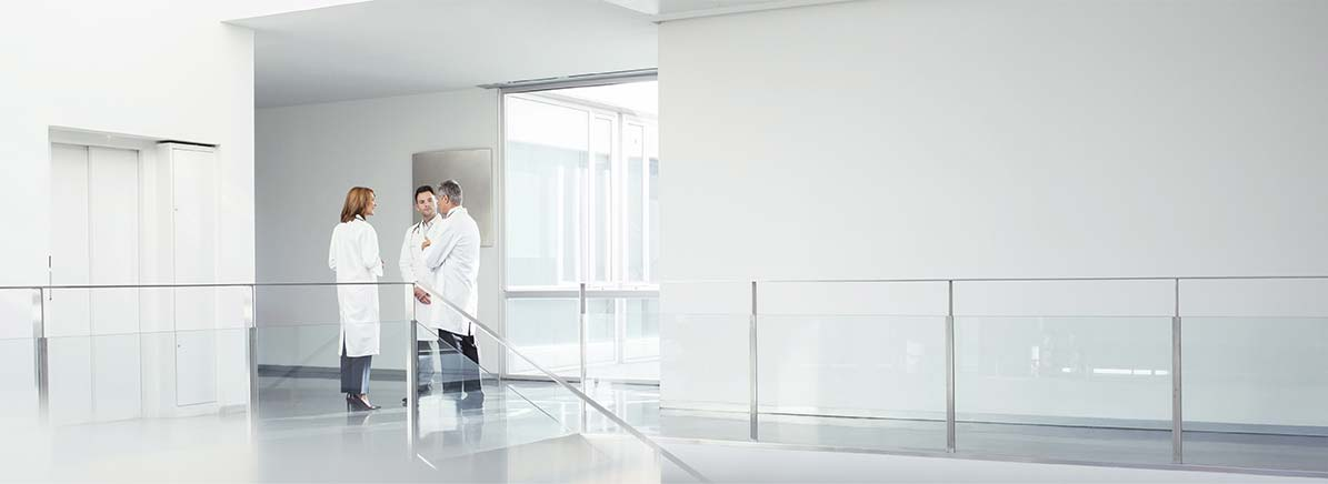 Physicians standing in hallway